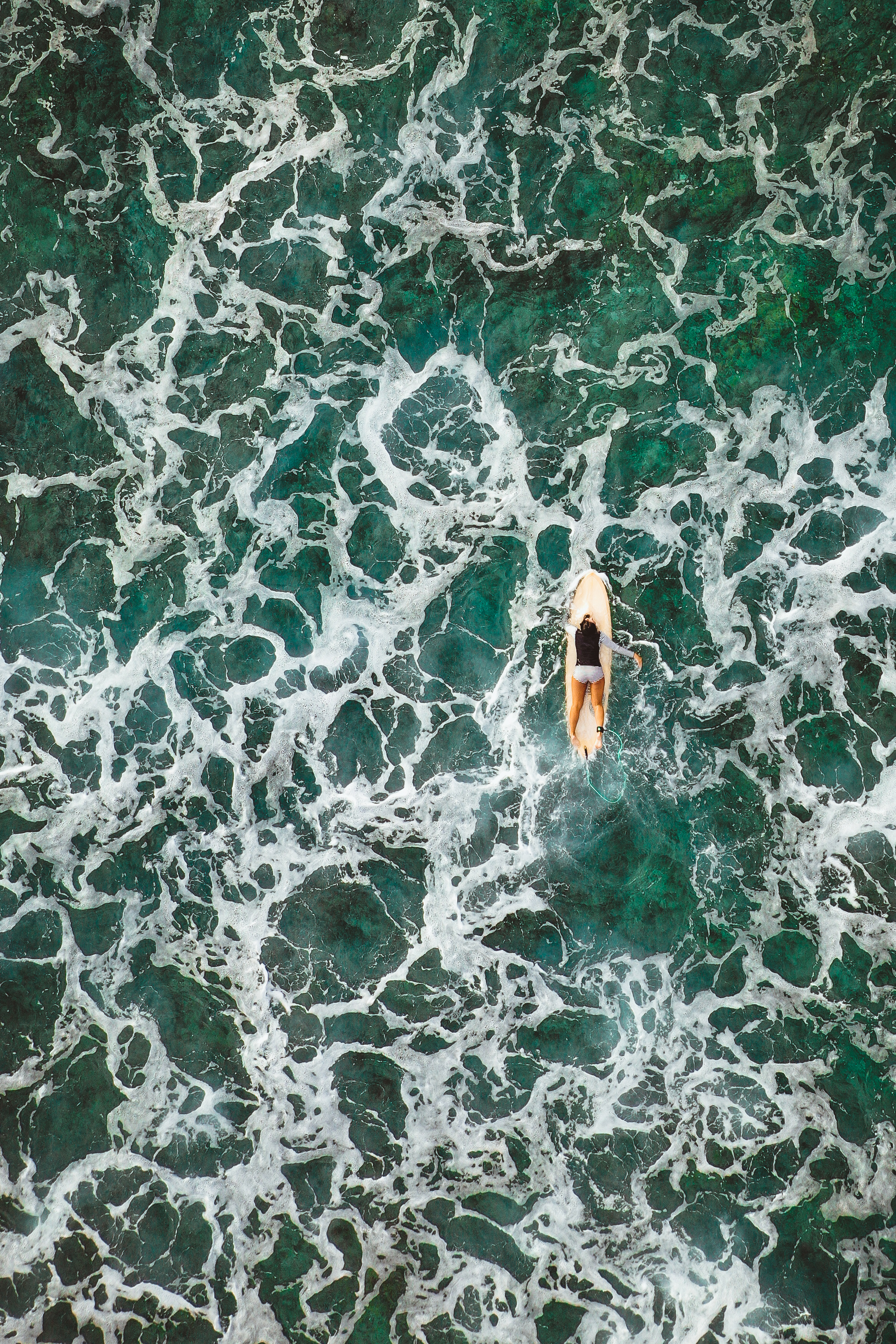 surfing woman from drone